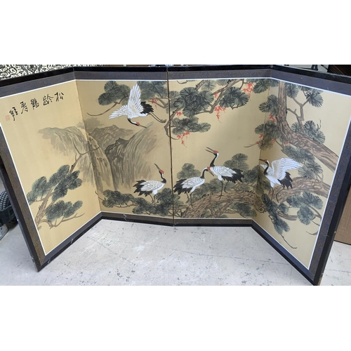 526A - A 20th century oriental hand painted on silk 4 fold comfort / table screen depicting five red crown ...