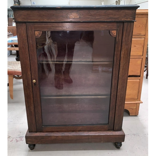 626 - A Victorian rosewood display cabinet with inlaid decoration enclosed by single glazed door...