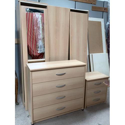 645 - A large modern light bedroom suite comprising 4 door wardrobe (3 mirrored) a 4 height chest of drawe...