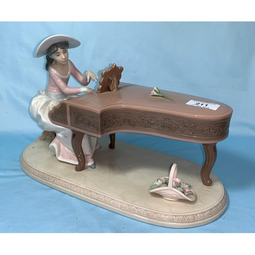 211 - A Lladro figure group of a girl playing a grand piano...