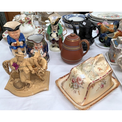 161 - An early 19th century black salt glazed coffee pot; an Eichwald boy and donkey pipe rack; 2 toby jug...