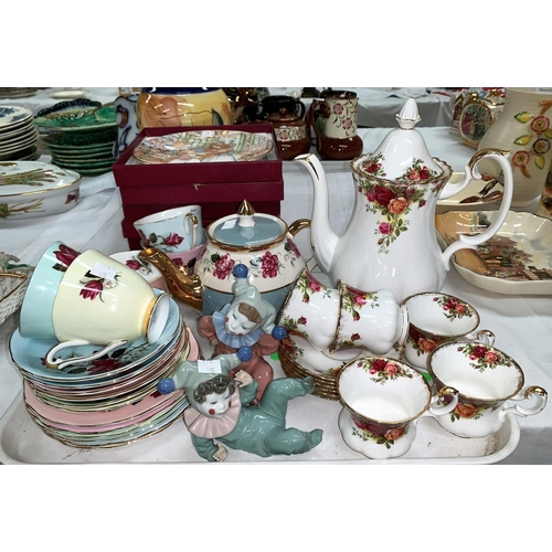 170 - A Royal Albert Country Roses tea pot and six cups and saucers, a Queen Anne part service and two sma...