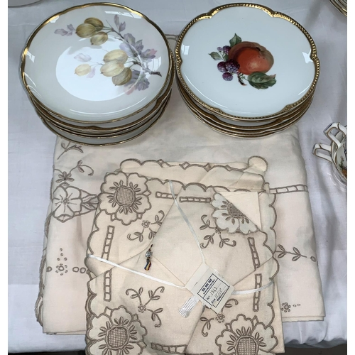 180 - Two Bavarian sets of 6 pottery dessert plates; a Madera table cloth and napkins...