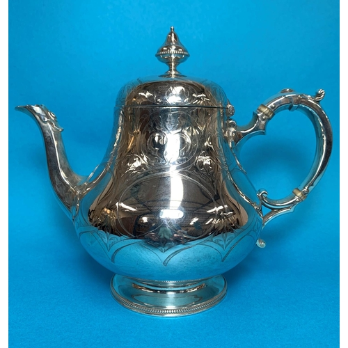 307 - A Victorian silver pear shaped teapot,  with chased decoration, monogrammed, London 1856, 27 oz...