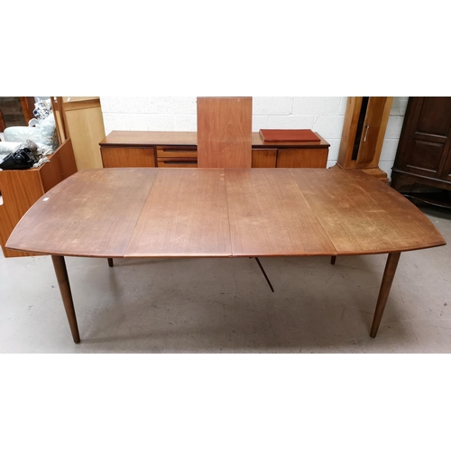 573 - A 1960's Danish teak dining suite comprising large rounded rectangular table with 3 spare leaves, ex...
