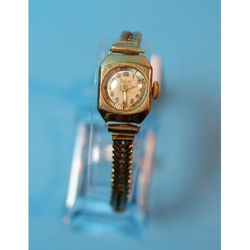 396 - A ladies Zodiac 9 carat hallmarked gold wristwatch on chevron link strap, stamped '375', 17.7 gm gro...