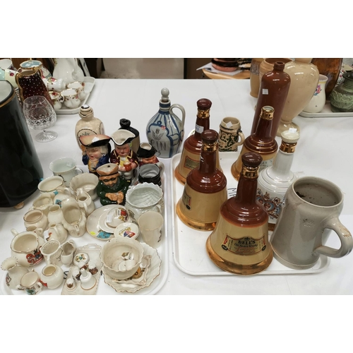 173 - A selection of Wade whisky decanters; other spirit containers; a selection of toby jugs; crested chi...