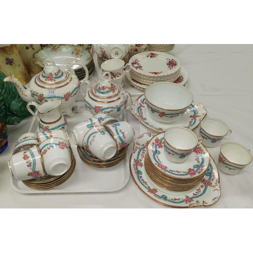 178 - A 19th century Rockingham style tea service with gilt and polychrome decorayion...