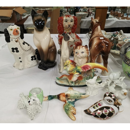 189 - Two reproduction Staffordshire dog, other ceramic animals...