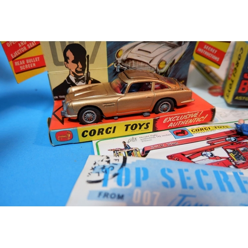 255E - An originally boxed Corgi Toys James Bond Astin Martin DB5 No 261 from Goldfinger, with metallic gol...