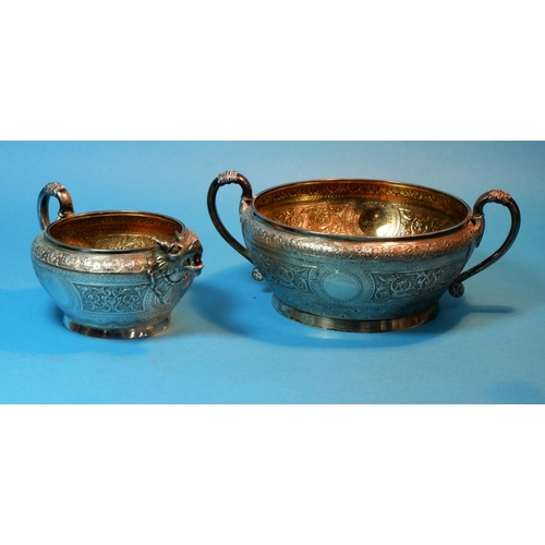 375 - A 19th century sugar bowl and cream jug with extensive chased relief decoration in the Indian manner...