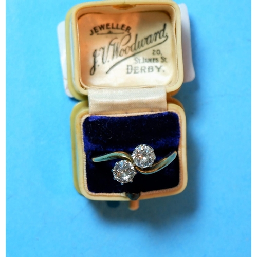 325 - A ladies dress ring set 2 old cut diamonds in crossover setting, unmarked yellow metal shank (stones...