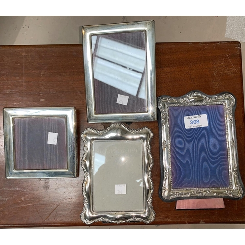 308 - A silver Victorian style photo frame; 3 silver plated photo frames...