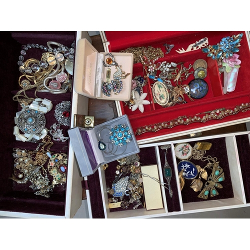 374 - A selection of costume jewellery; 2 jewellery boxes...