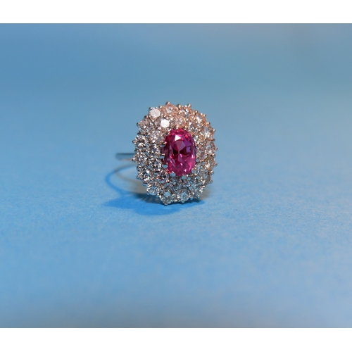 345 - A white metal pink sapphire and diamond cluster dress ring, the central pink stone approximately 3 c...
