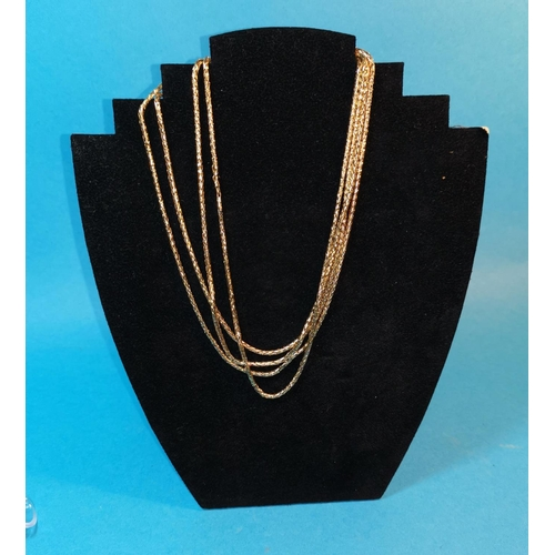 393C - A yellow metal double woven strand chain, unmarked, tests as 9c, 27gm...