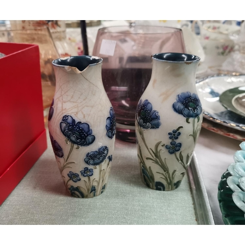 194 - A pair of Moorcroft Macintyre cornflower vases (badly crazed and chipped); 2 Caithness vases; 2 pape...