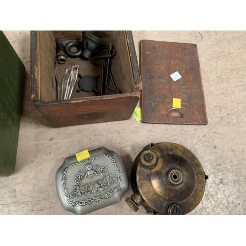 450 - A pair of WWII night goggles in military box; a boxed brass primus stove; a compass; a trinket box a...