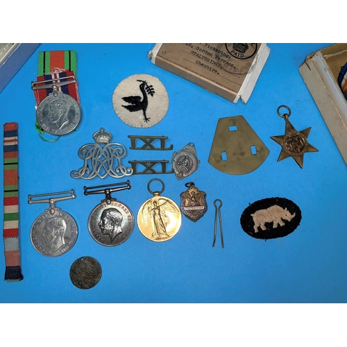 451 - A WWI pair of medals, 22384 Pte. E.E. PICKERING, S. LAN REG, a pair of WWII medals with paperwork, a...