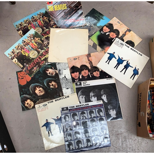 530 - THE BEATLES: a collection of 1960's and other issues of their classis LPs, in played condition...