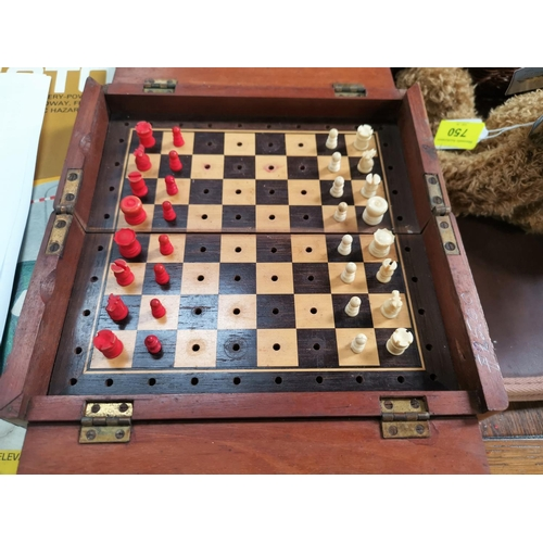 751 - A 19th century mahogany cased folding travelling chess set with bone pieces...