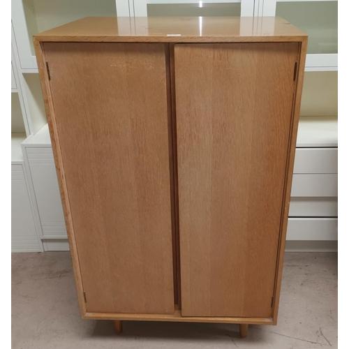 98 - A 1960's gents wardrobe in part fitted light oak