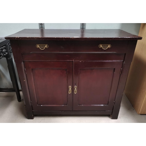 46 - An Edwardian stained pine side cabinet with frieze drawer and double cupboard...