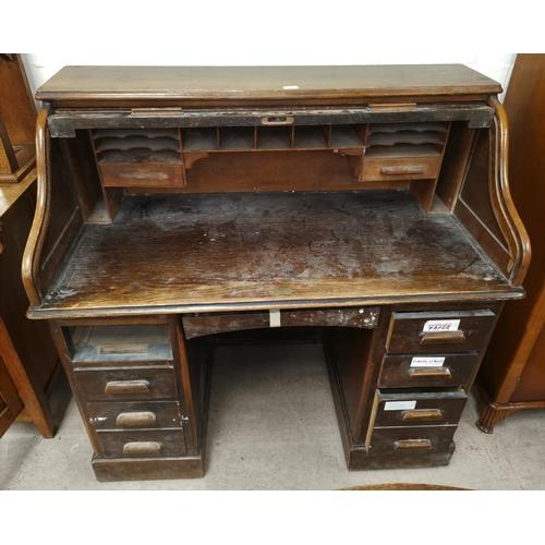 548 - An 'S' roll top twin pedestal desk, vintage oak finish, 48