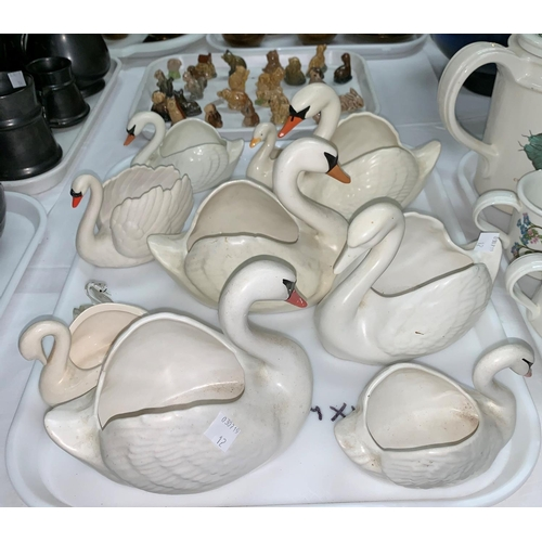 36 - A collection of Wade Whimsies, various pottery swans etc.; A selection of Prinknash pottery...
