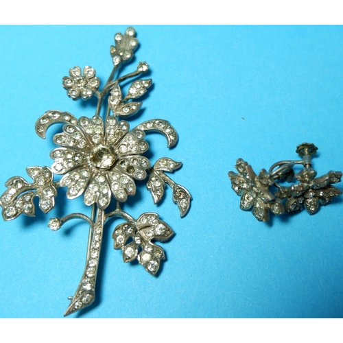 309 - A French floral spray brooch set silver and paste; 2 pairs of similar earrings...