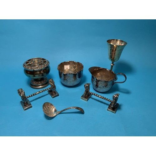 348 - A silver thimble; similar sugar tongs; a scent bottle; EPNS...