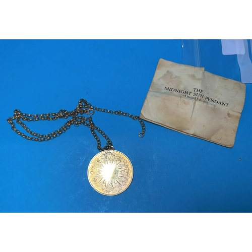 349 - A silver gilt medallion on 9 carat gold chain, 11 gm approx...