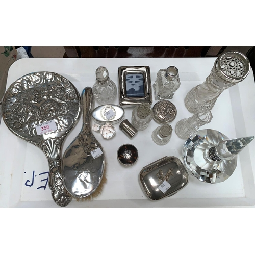 350 - A silver back cherub mirror; an Art Deco slice cut scent bottle with spire stopper; silver mounted t...