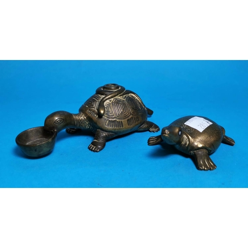 285A - A Chinese bronze tortoise with snake on its back, 5.25