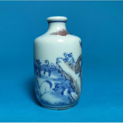285 - A Chinese porcelain scent bottle decorated in underglaze blue and brown with monkeys, horses, buffal...