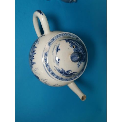 286A - An 18th / 19th century Chinese porcelain teapot decorated in underglaze blue with buildings and tree...