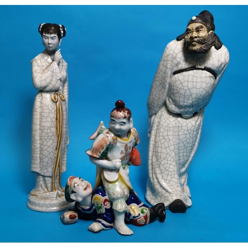 293A - Two Chinese crackle glaze figures of a man and woman, height 11