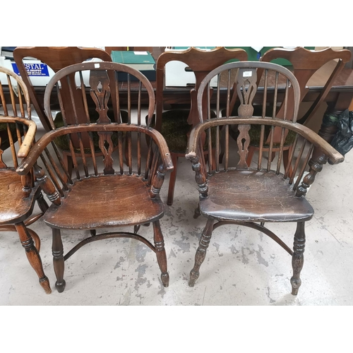 538 - A 19th century near pair of Windsor chairs with low backs and crinoline stretcher