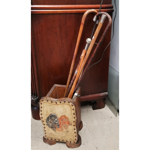 503C - A leather faced stick stand and various silver mounted walking sticks, riding crops etc