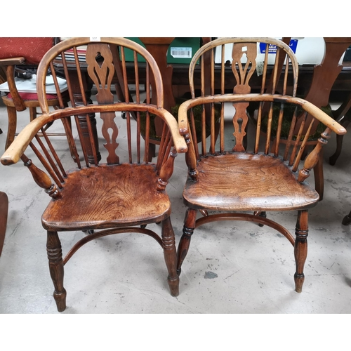 537 - A 19th century near pair of Windsor chairs with low backs and crinoline stretcher