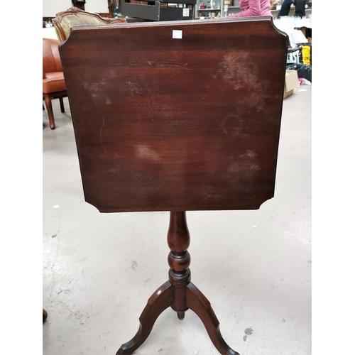 543 - An Edwardian mahogany pot cupboard with single door; a 19th/20th century mahogany table with shaped ...
