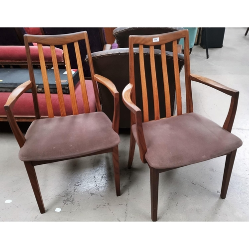 544 - A pair of G-Plan teak carver chairs with slat backs