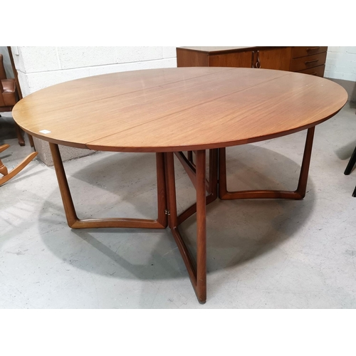 541 - A 1960's teak dining suite comprising oval drop leaf table and 8 chairs,in green fabric, by Charles ...