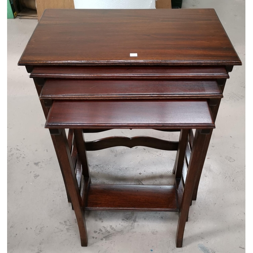 557a - A mahogany nest of 'quartetto' nest of tables with rectangular tops