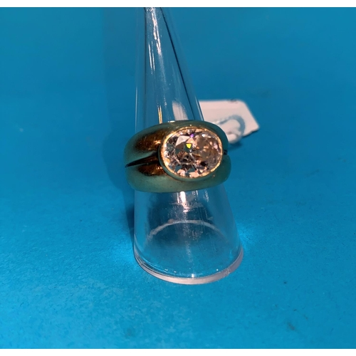 356 - A gent's 9 carat hallmarked gold gypsy style ring, the split shank set large simulated oval diamond,...