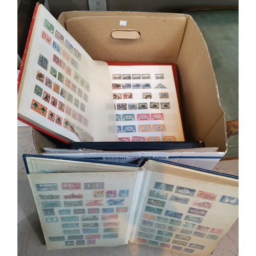 393 - A collection of world stamps in stockbooks to include South Africa...