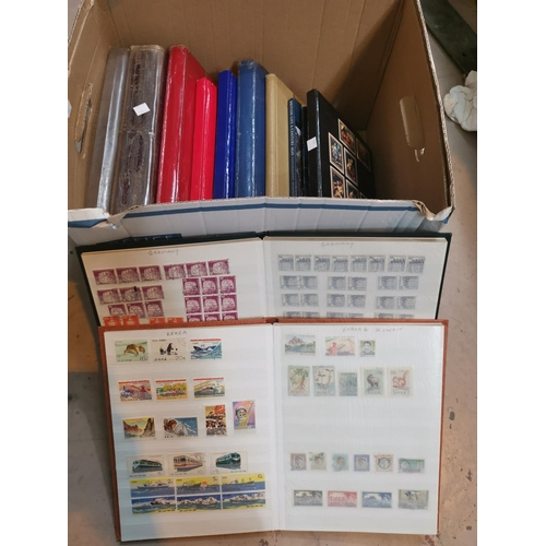 394 - A collection of world stamps in stockbooks to include New Zealand and Canada...