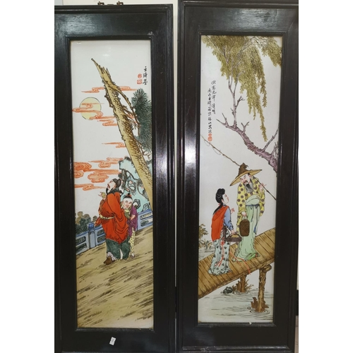 280A - A pair of Chinese porcelain wall hanging rectangular plaques with traditional scenes and signatures...