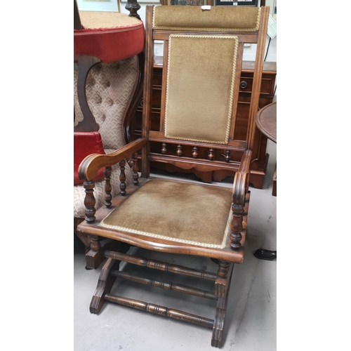 521 - An American stained wood rocking chair