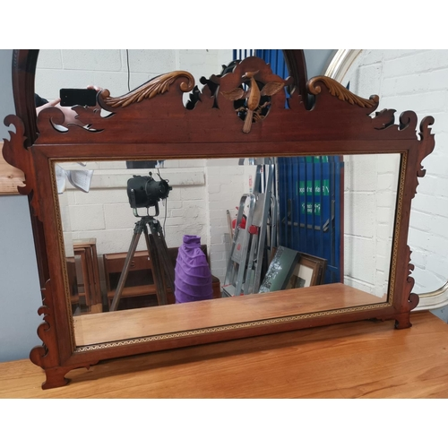 527 - An early 20th century wall mirror in Chippendale style fretwork frame
